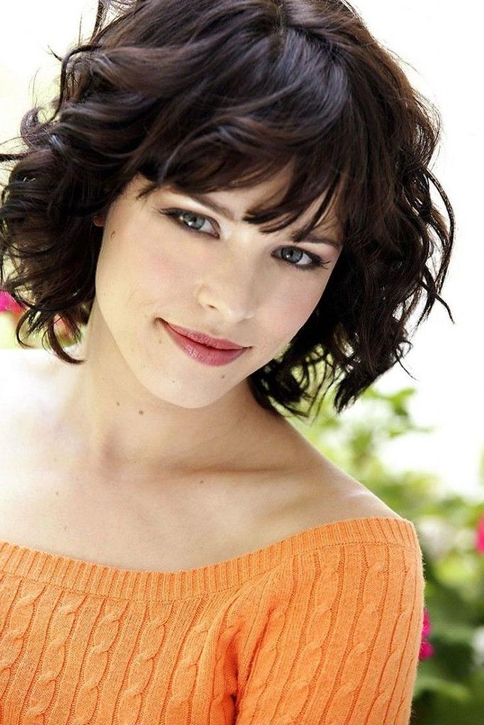Featured Photo of Voluminous Wavy Layered Hairstyles With Bangs