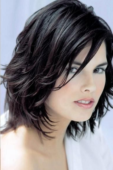 Black Layered Long Bob Haircut With Long Side Swept Piecey Bangs Pertaining To Newest Brunette Feathered Bob Hairstyles With Piece Y Bangs (View 13 of 25)