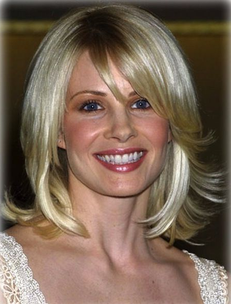 Blonde Mid Length Shag Flipped Hair With Bangs | Medium Hairstyles In Most Recently Layered And Flipped Hairstyles For Medium Length Hair (View 6 of 25)