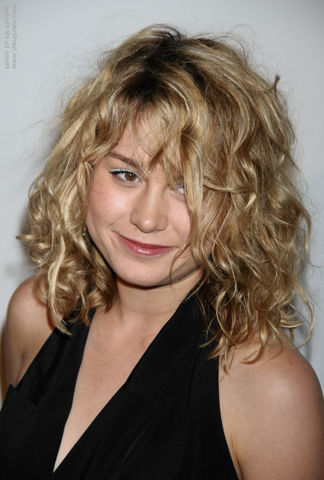 Brie Larson's Medium Long Haircut For A Natural Look With Messy Intended For Most Popular Medium Messy Curly Haircuts (View 8 of 25)