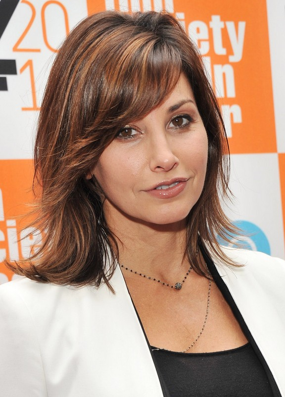 Gina Gershon Trendy Medium Wavy Hairstyle With Layers For Thick Hair Inside Most Popular Medium Feathered Haircuts For Thick Hair (Gallery 13 of 25)
