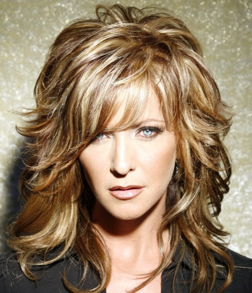 Textured Bangs Throughout Latest Voluminous Wavy Layered Hairstyles With Bangs (View 6 of 25)