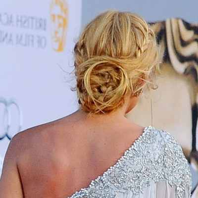10 Bridal Updos That Don't Look Like Bridal Updos – Allure Regarding Loose Updo Wedding Hairstyles With Whipped Curls (View 12 of 25)