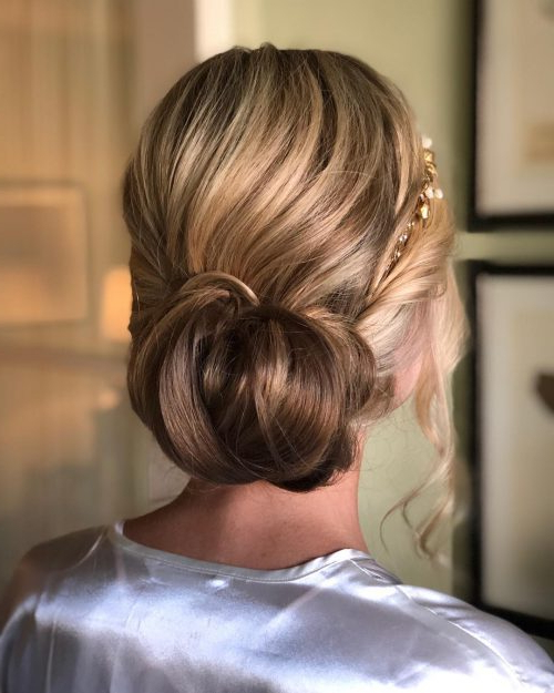 15 Gorgeous Wedding Updos For Brides In 2019 With Voluminous Chignon Wedding Hairstyles With Twists (View 22 of 25)