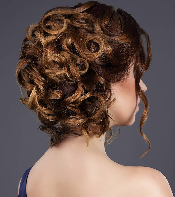 20 Incredibly Stunning Diy Updos For Curly Hair Intended For Wavy Low Bun Bridal Hairstyles With Hair Accessory (View 14 of 25)
