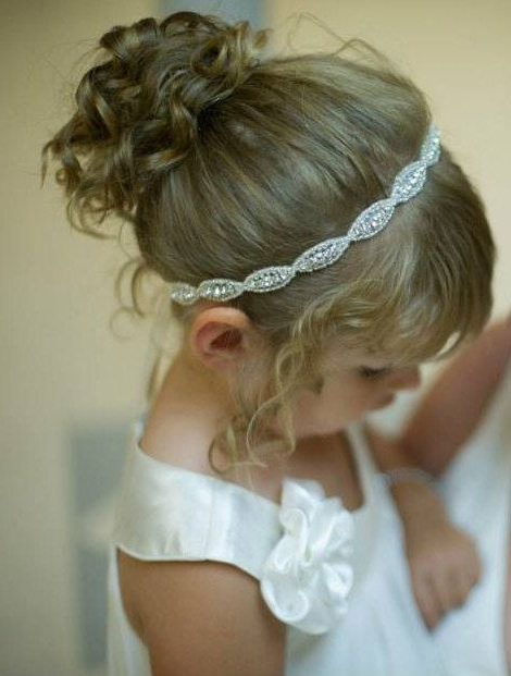 21 Flower Girl Items We Can't Get Enough Of! | Flowergirl Hair With Regard To High Updos With Jeweled Headband For Brides (View 10 of 25)