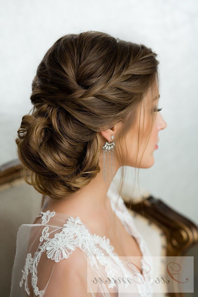 25 Drop Dead Bridal Updo Hairstyles Ideas For Any Wedding Venues Intended For French Twist Wedding Updos With Babys Breath (View 11 of 25)