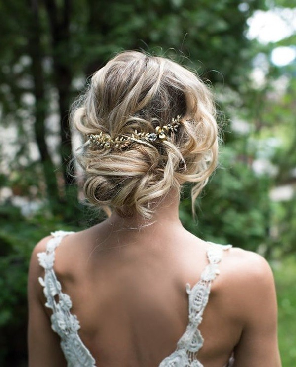 25 Drop Dead Bridal Updo Hairstyles Ideas For Any Wedding Venues Pertaining To Low Twisted Bun Wedding Hairstyles For Long Hair (View 22 of 25)