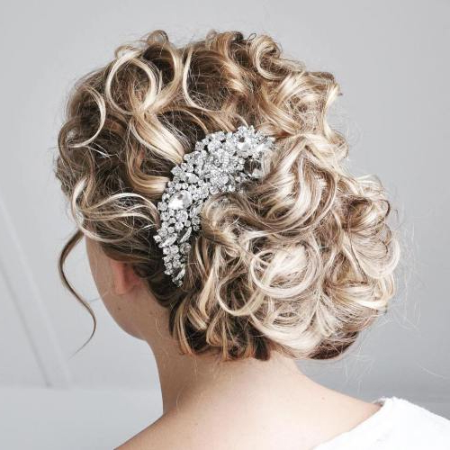 25 Most Elegant Looking Curly Wedding Hairstyles – Haircuts Inside Wavy And Wispy Blonde Updo Wedding Hairstyles (View 23 of 25)