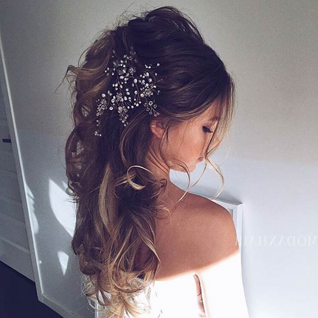 28 Trendy Wedding Hairstyles For Chic Brides | Stayglam For Wavy Low Bun Bridal Hairstyles With Hair Accessory (View 25 of 25)