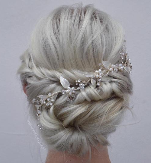 35 Chic Wedding Hair Updos For Elegant Brides – My Stylish Zoo Within Wavy Low Bun Bridal Hairstyles With Hair Accessory (View 19 of 25)