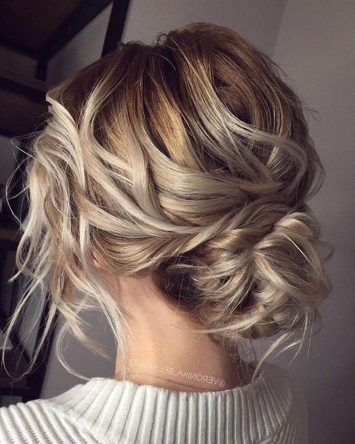 Featured Photo of Wavy And Wispy Blonde Updo Wedding Hairstyles