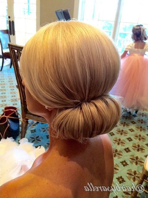 40 Chic Chignon Buns That Bring The Class Into Formal And Casual Throughout Sleek Low Bun Rosy Outlook Wedding Updos (View 14 of 25)
