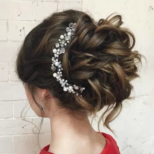 Featured Photo of Large Curly Bun Bridal Hairstyles With Beaded Clip