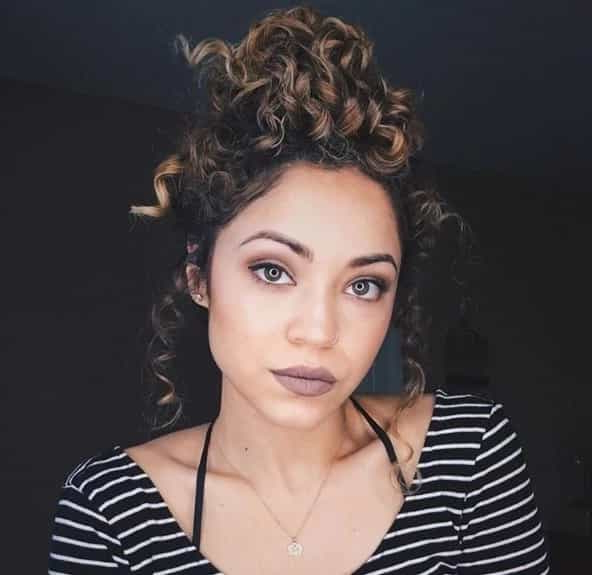5 Smartest Messy Buns For Curly Hair [2019] Throughout Tied Back Ombre Curls Bridal Hairstyles (View 18 of 25)