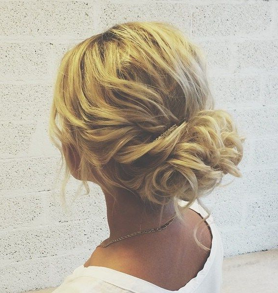 5 Smartest Messy Buns For Curly Hair [2019] With Regard To Wavy Low Bun Bridal Hairstyles With Hair Accessory (View 7 of 25)