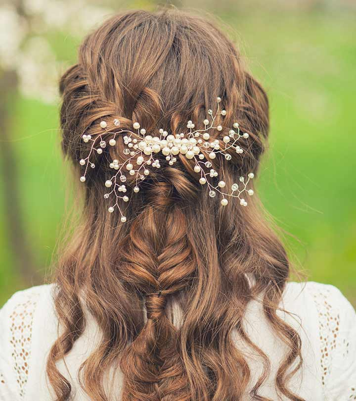 50 Simple Bridal Hairstyles For Curly Hair With Regard To Wavy Low Bun Bridal Hairstyles With Hair Accessory (View 5 of 25)