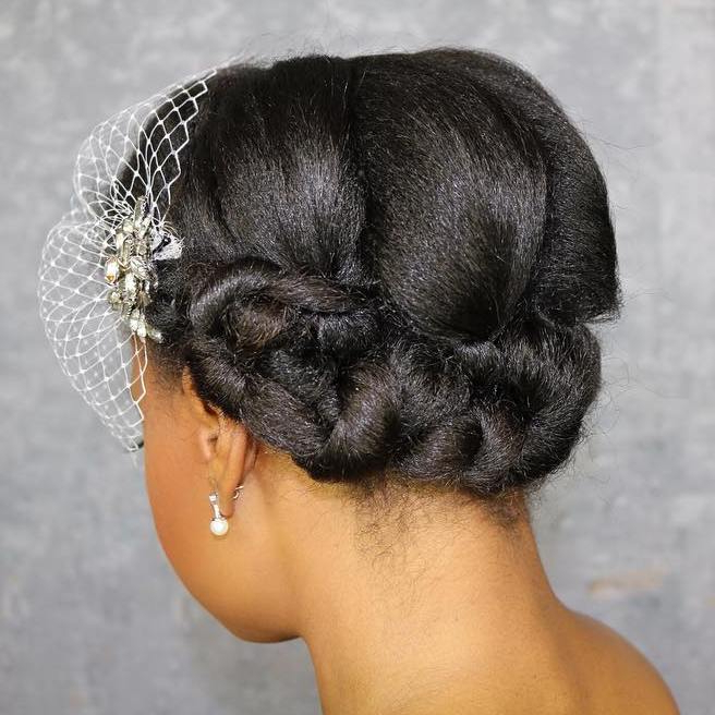 50 Superb Black Wedding Hairstyles With Regard To Wavy Low Bun Bridal Hairstyles With Hair Accessory (View 4 of 25)