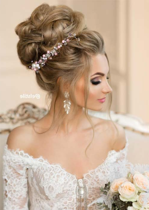 53 Swanky Wedding Updos For Every Bride To Be – Glowsly In Sleek And Voluminous Beehive Bridal Hairstyles (View 7 of 25)