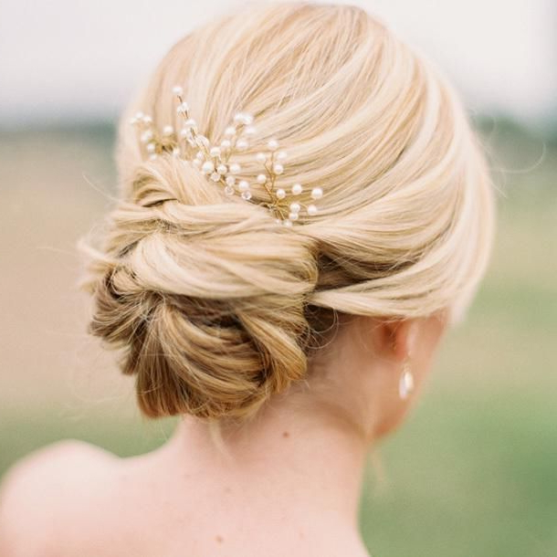 7 Stunning Wedding Updos For Every Type Of Bride | Wedding Hair In Embellished Twisted Bun For Brides (Gallery 2 of 25)