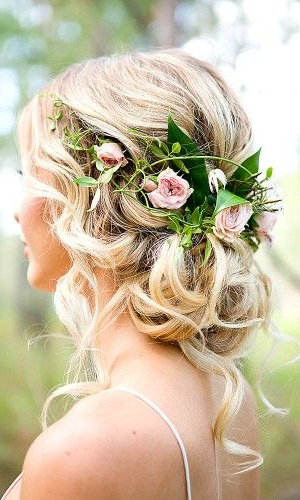 Featured Photo of Bohemian Curls Bridal Hairstyles With Floral Clip