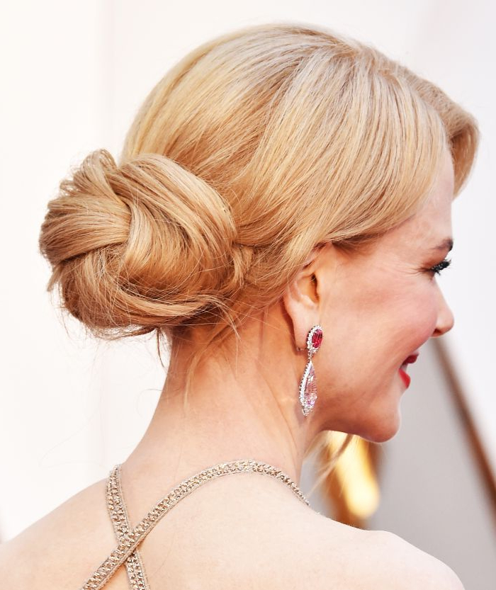 8 Low Bun Hairstyles To Save You On Lazy Mornings | Byrdie In Twisted Low Bun Hairstyles For Wedding (Gallery 23 of 25)
