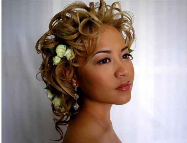 Asian Wedding Curly Updo With White Roses And Curl Bangs In Blonde Inside Curly Blonde Updo Hairstyles For Mother Of The Bride (Gallery 17 of 25)
