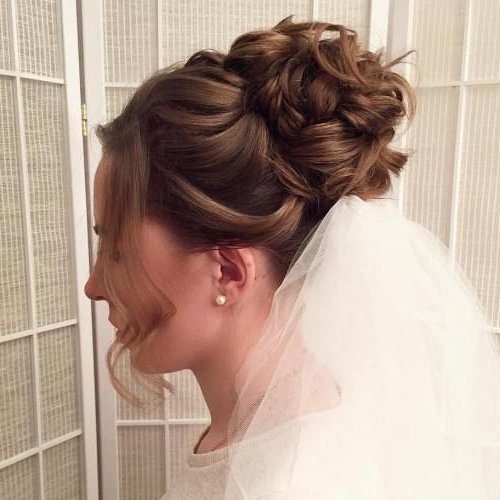 Best Curly Bridal Bun With Veil A Bread Is One Amongst The Dateless with regard to Curly Bridal Bun Hairstyles With Veil