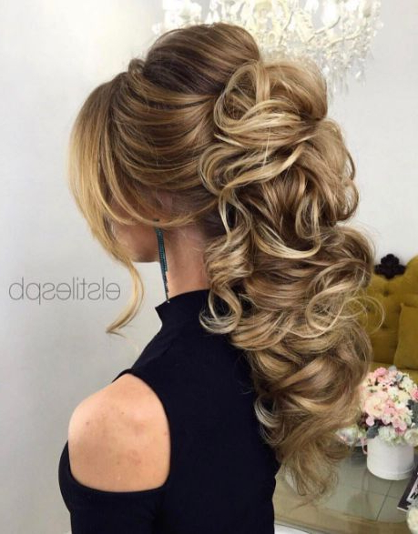 Braided Loose Curls Low Updo Wedding Hairstyle #2668480 – Weddbook With Regard To Subtle Curls And Bun Hairstyles For Wedding (View 5 of 25)