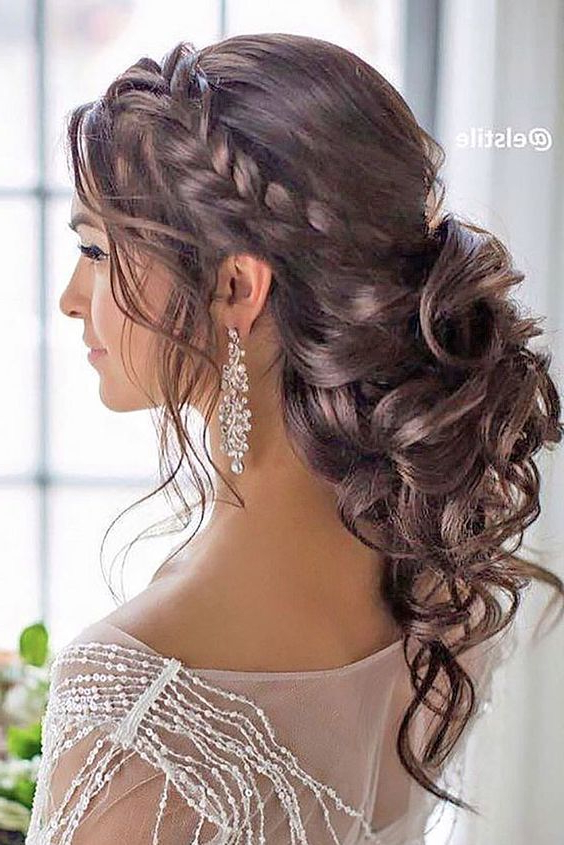 Braided Loose Curls Low Updo Wedding Hairstyle | Wedding Hairstyles Pertaining To Large Curl Updos For Brides (View 2 of 25)