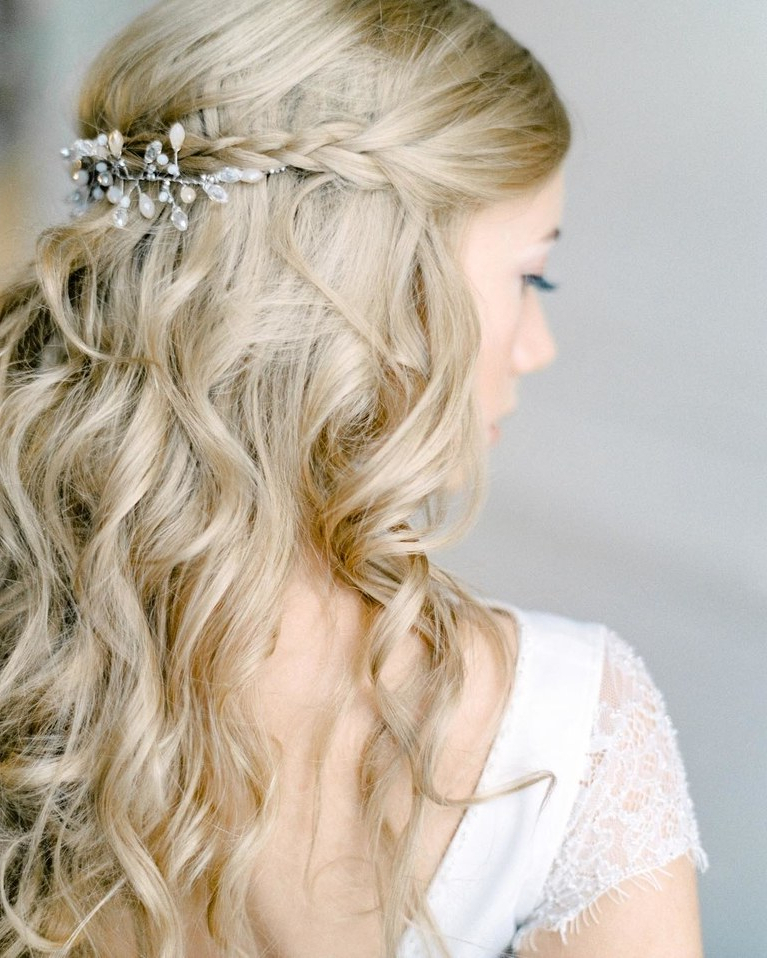 Half Up, Half Down Wedding Hairstyles For Every Type Of Bride   Brides Within Accessorized Undone Waves Bridal Hairstyles (View 17 of 25)