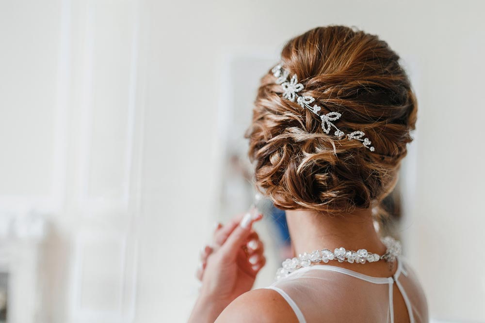 It's Wedding Season! Check Out These Trending Wedding Hairstyles In Embellished Twisted Bun For Brides (View 9 of 25)