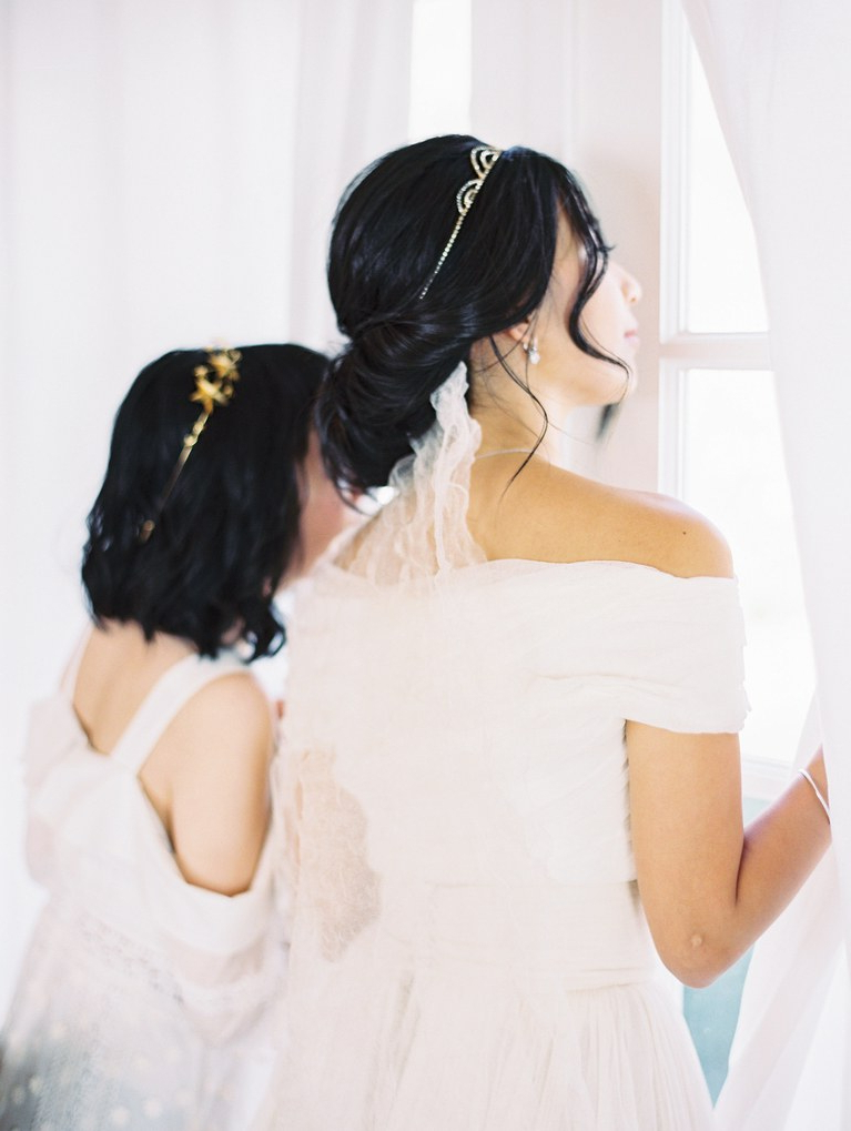 Loose Low Bun Wedding Hairstyle With Veil Tucked Underneath   Brides Inside Bridal Chignon Hairstyles With Headband And Veil (View 11 of 25)