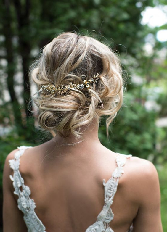 Low Updo Gold Leaf Hairpiece Wedding Hairstyle | Wedding Hair With Twisted Low Bun Hairstyles For Wedding (View 2 of 25)