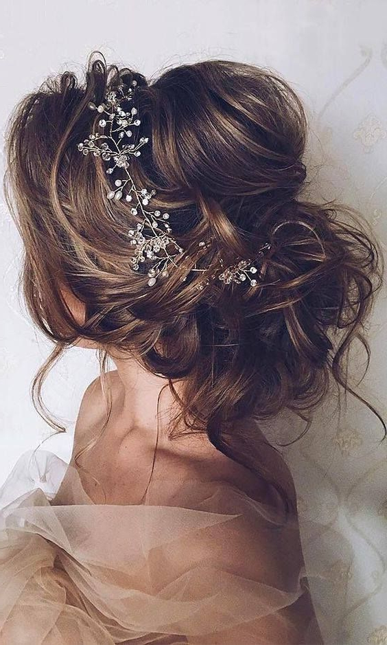 Mane Addicts 26 Gorgeous Bridal Hair Ideas We Found On Pinterest Inside Messy Buns Updo Bridal Hairstyles (View 20 of 25)