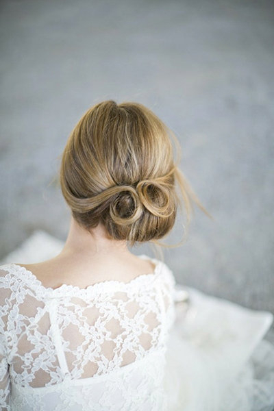 New Twists On Popular Wedding Hairstyles | Bridalguide For Embellished Twisted Bun For Brides (View 22 of 25)