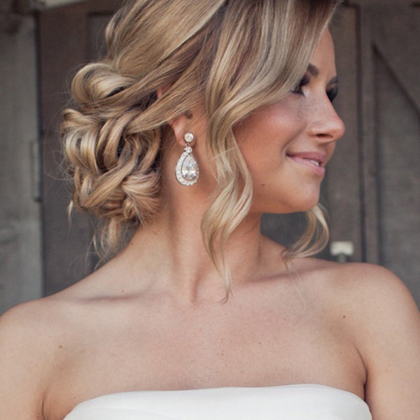 New Twists On Popular Wedding Hairstyles | Bridalguide Intended For Bumped Twist Half Updo Bridal Hairstyles (View 17 of 25)