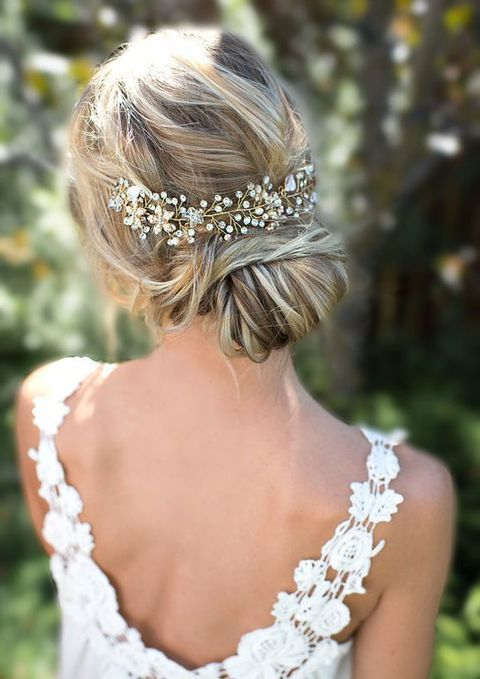 Picture Of A Beautiful Low Bun With Twisted Hair And A Sparkling Throughout Twisted Low Bun Hairstyles For Wedding (View 9 of 25)