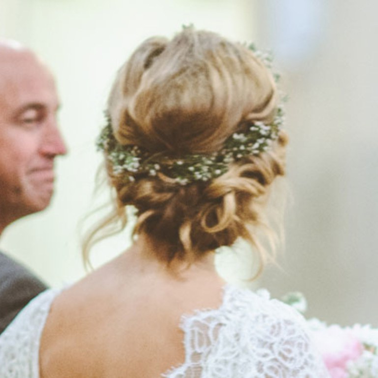 Pinterest Wedding Hairstyle We Love: A Twisted Low Bun With A Flower With Low Twisted Bun Wedding Hairstyles For Long Hair (View 8 of 25)
