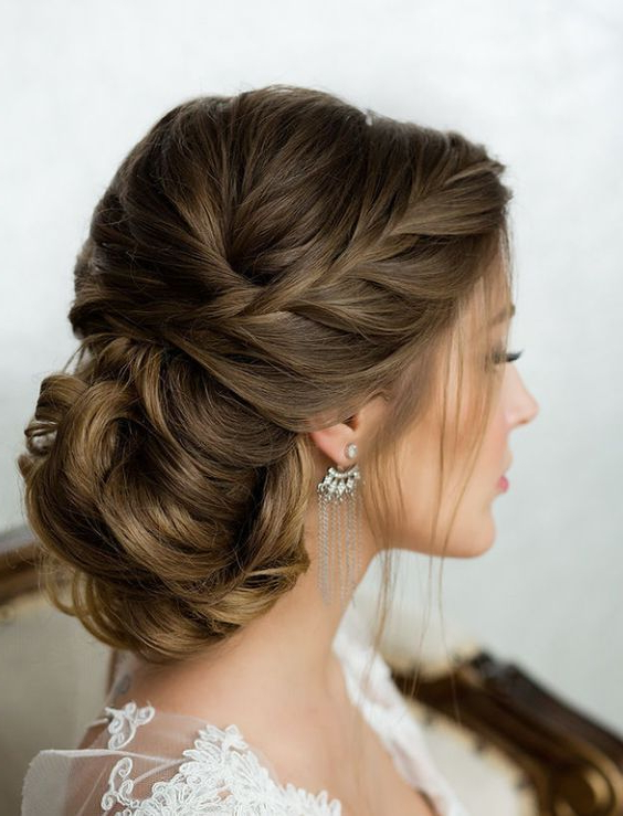 Side French Braid Low Wavy Bun Wedding Hairstyle | Cassie's Hopeful Pertaining To Embellished Caramel Blonde Chignon Bridal Hairstyles (View 1 of 25)