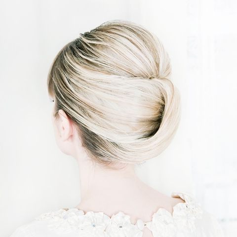 The Cool Girl's Guide To Wearing Your Hair Up For Your Wedding Inside Infinity Wedding Updos (View 25 of 25)