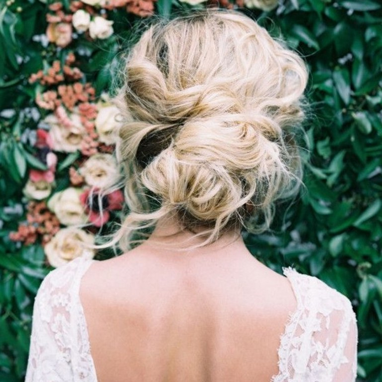 These Are The Most Popular Wedding Hairstyles On Pinterest Right Now Intended For Messy Buns Updo Bridal Hairstyles (View 16 of 25)