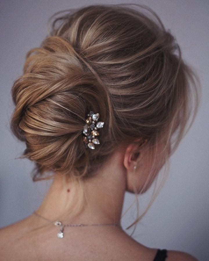This French Twist Updo Hairstyle Perfect For Any Wedding Venue Pertaining To Sleek French Knot Hairstyles With Curls (View 25 of 25)