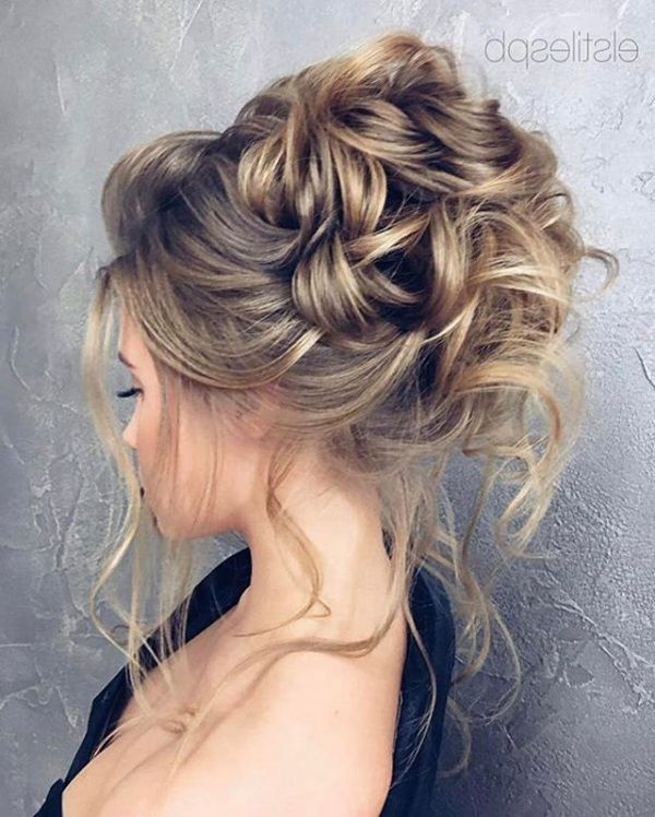 Featured Photo of Large Bun Wedding Hairstyles With Messy Curls