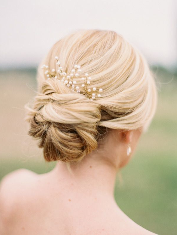Top 20 Most Pinned Bridal Updos | The Fashionable Bride | Pinterest Pertaining To Wavy Low Bun Bridal Hairstyles With Hair Accessory (View 12 of 25)