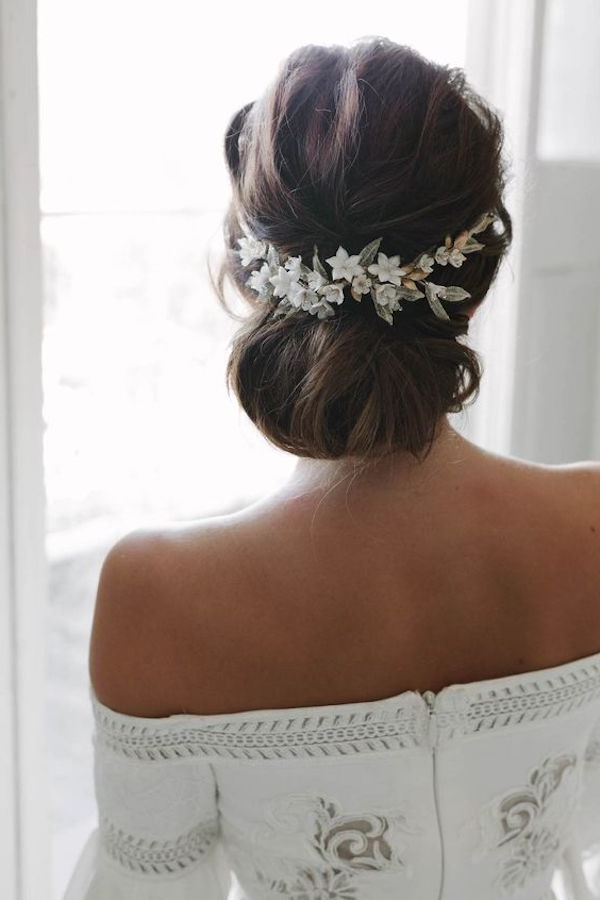 Top 8 Wedding Hairstyles For Bridal Veils Inside Wavy Low Bun Bridal Hairstyles With Hair Accessory (View 15 of 25)