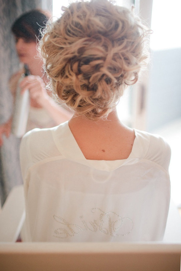Untamed Tresses | Naturally Curly Wedding Hairstyles Pertaining To Bohemian Curls Bridal Hairstyles With Floral Clip (View 9 of 25)