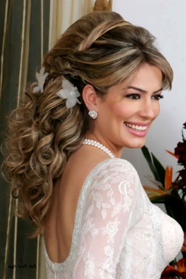 Upswept Curls And Big Bump With Floral Adornment's Wedding Hairstyle With Regard To Bumped Hairdo Bridal Hairstyles For Medium Hair (View 6 of 25)