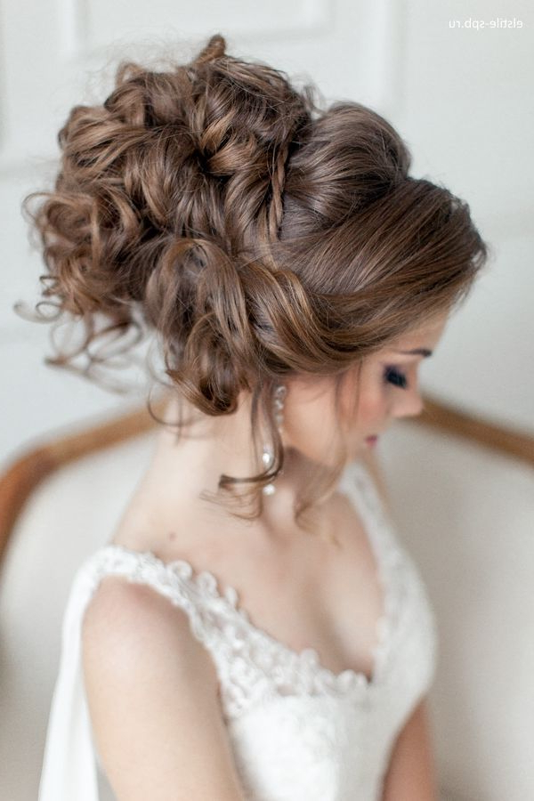 Venician Textured Curls Woven Into A High Messy Bun | Simple Beauty With Regard To Large Bun Wedding Hairstyles With Messy Curls (View 16 of 25)