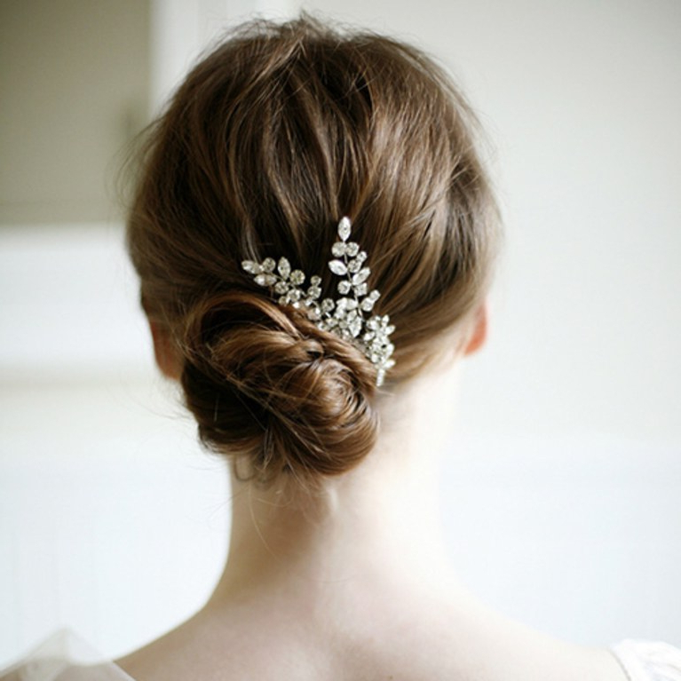 Wedding Hair Ideas: Fresh Twists On The Classic Bridal Bun   Brides Pertaining To Embellished Twisted Bun For Brides (View 25 of 25)